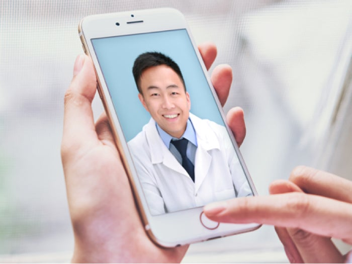 Doctor in a virtual dental consultation.